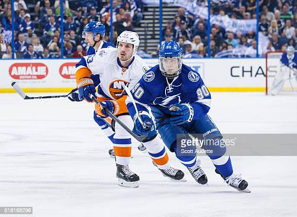Vladislav Namestnikov of the Tampa Bay Lightning skates against Casey Cizikas of the New York Islanders during the first period at the Amalie Arena...