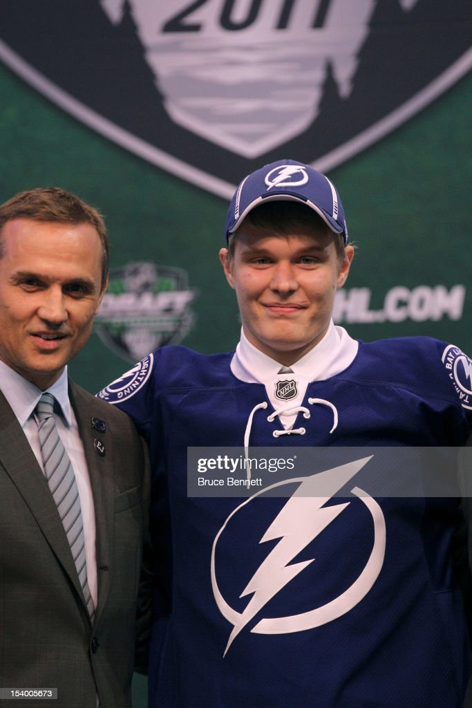 Vladislav Namestnikov poses with Steve Yzerman and other members of Tampa Bay Lightning during day one of the 2011 NHL Entry Draft at Xcel Energy Center on June 24, 2011 in St Paul, Minnesota.