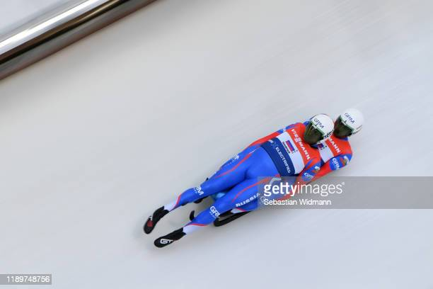 Vladislav Yuzhakov and Iurii Prokhorov of Russia compete in the Relay competition during the FIL Luge World Cup at OlympiaRodelbahn on November 24...