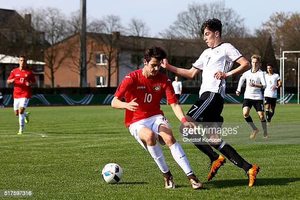 Vladislav Zhikov of Bulgaria challenges Kai Havertz of Germany during the U17 Euro Qualification match between Germany and Bulgaria at Stadium...