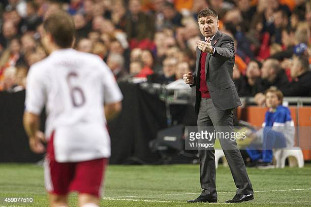 Vladislavs Gabovs of Latvia coach Marians Pahars of Latvia during the match between Netherlands and Latvia on November 16 2014 at the Amsterdam Arena...