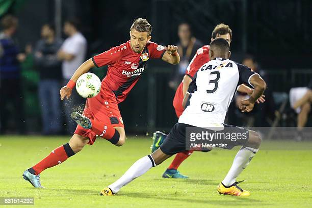 Vladlen Yurchenko of Bayer Leverkusen dribbles the ball against Jesiel of Atletico Mineiro at ESPN Wide World of Sports Complex on January 11 2017 in...