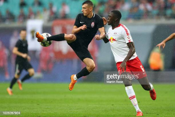 Vladyslav Kabayev of Zorya is challenged by Ibrahima Konate of Leipzig during the UEFA Europa League Qualifying PlayOff second leg match between RB...