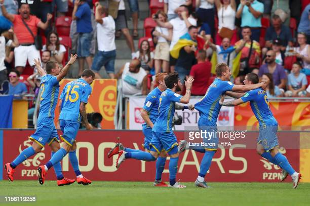 Vladyslav Supriaha of Ukraine celebrates with teammates after scoring his team's first goal during the 2019 FIFA U20 World Cup Final between Ukraine...