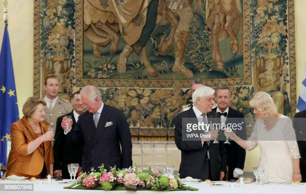 Vlassia PeltsemiPavlopoulous and Prince Charles Prince of Wales and President of Greece Prokopis Pavlopoulos and Camilla Duchess of Cornwall toast...