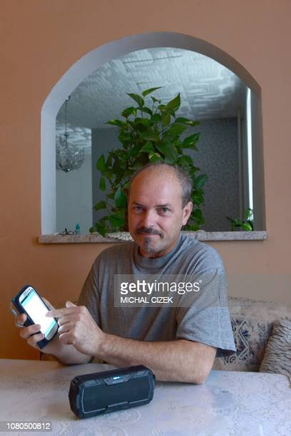 Vlastimil Gular who lost his larynx and his voice speaks in his own voice via a mobile phone using the special app to type in what he wants to say...
