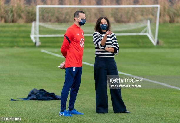 Vlatko Andonovski and Kate Markgraf of the USWNT talk during a training session at Dick's Sporting Goods Park training fields on October 20 2020 in...