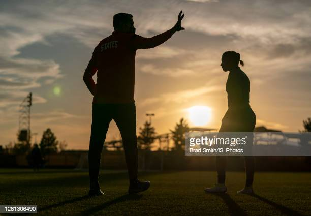 Vlatko Andonovski of the USWNT talks with Crystal Dunn during a training session at Dick's Sporting Goods Park training fields on October 19 2020 in...