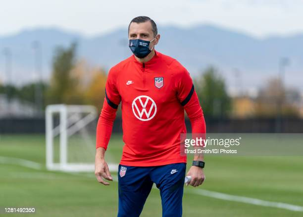 Vlatko Andonovski of the USWNT watches his team during a training session at Dick's Sporting Goods Park training fields on October 20 2020 in...