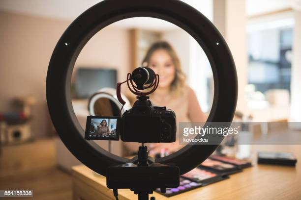 vlogger doing makeup - beauty care occupation stock photos and pictures