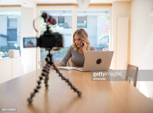 vlogger filming herself working - tripod stock pictures, royalty-free photos & images