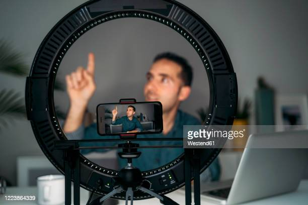 vlogger filming with smartpone at home - tutorial stock pictures, royalty-free photos & images