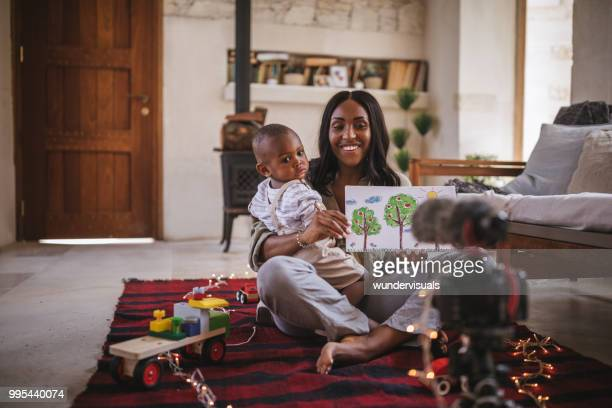 vlogger mother with little son recording video for social media - influencer stock pictures, royalty-free photos & images