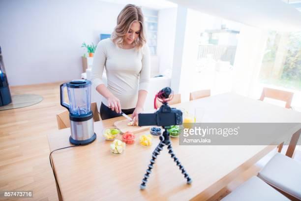 Vlogger preparing a smoothie