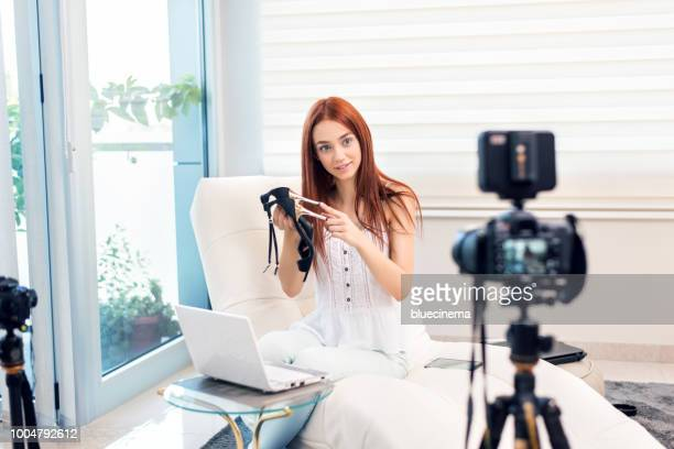 vlogger recording a shoes video for her vlog - influencer stock pictures, royalty-free photos & images