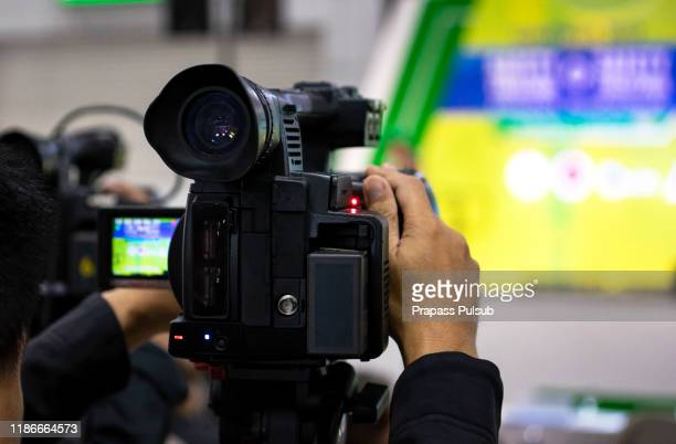 vlogger recording broadcas press and media photographer on duty in public news coverage event for reporter and mass communication - multimedia stock pictures, royalty-free photos & images