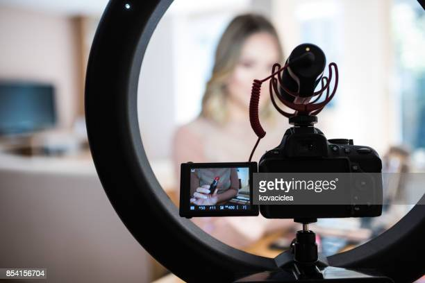 vlogger reviewing make-up products - influencers stock pictures, royalty-free photos & images