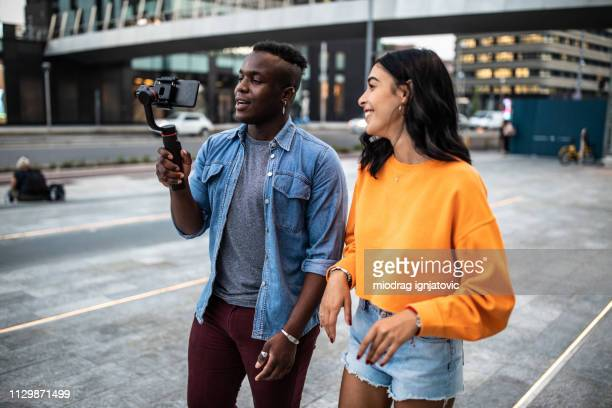 vloggers on the street - vlogging stock pictures, royalty-free photos & images