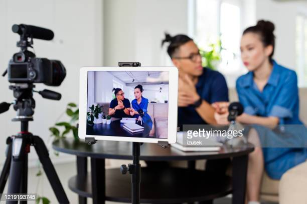 vloggers recording a video blog - izusek stock pictures, royalty-free photos & images