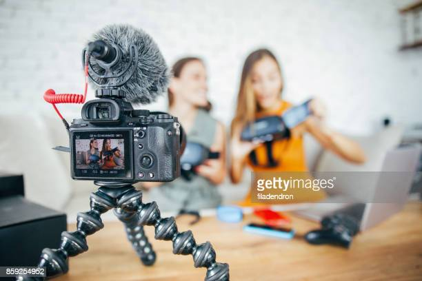 vloggers reviewing vr technology - sound recording equipment stock pictures, royalty-free photos & images
