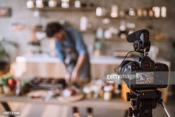 vlogging about food preparation - filming stock pictures, royalty-free photos & images