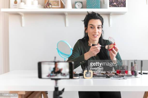 vlogging about make-up - social media marketing stock pictures, royalty-free photos & images