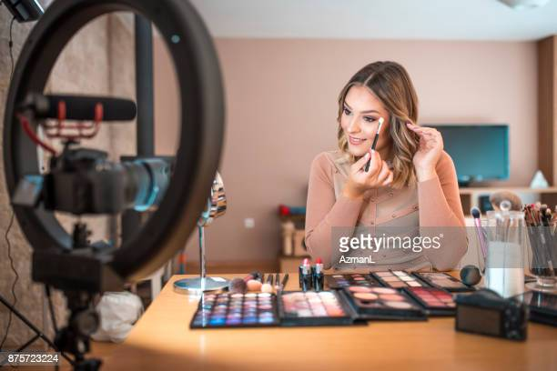 vlogging about make-up - influencer stock pictures, royalty-free photos & images