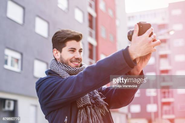 Vlogging. Young man recording video for his vlog