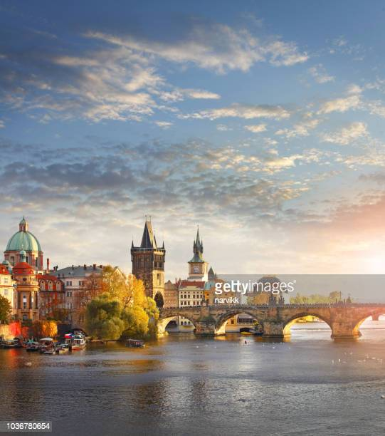 vltava river and charles bridge in prague - charles bridge stock photos and pictures