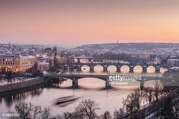 vltava river and old town in winter, prague, czech republic - prague stock pictures, royalty-free photos & images