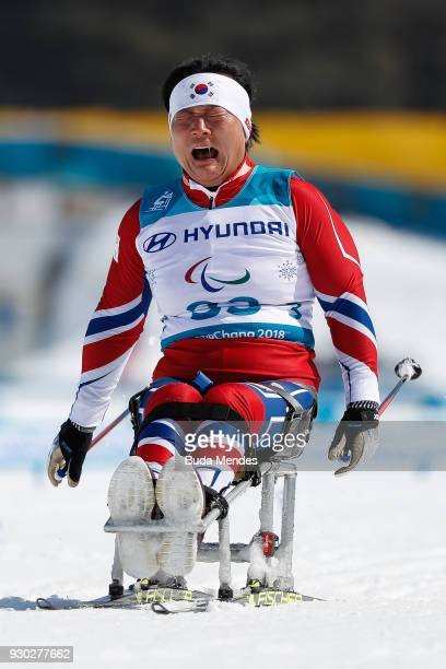 Vo Ra Mi Seo of Korea cries after crossing the finish line during the Women's Cross Country 12km Sitting event at Alpensia Biathlon Centre during day...