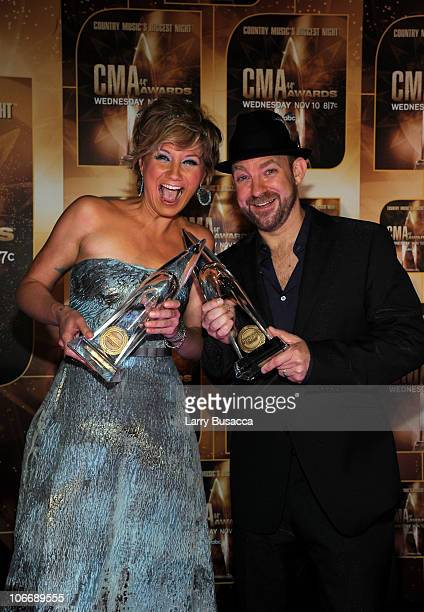 Vocal Duo of the Year winners Jennifer Nettles and Kristian Bush of Sugarland poses in the press room at the 44th Annual CMA Awards at the...