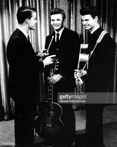 Vocal duo The Everly Brothers consisting of Don Everly and Phil Everly appear on an episode of American Bandstand with Dick Clark on April 5 1957 in...