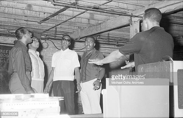 B vocal group 'The Four Tops' rehearses in the basement of the Apollo Theatre with their choreographer Cholly Atkins in 1964 in New York City New...