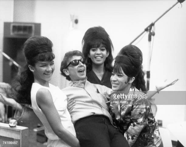 """Vocal trio """"The Ronettes"""" pose for a 1963 candid portrait with Phil Spector while recording in Los Angeles, California at Gold Star Studios in 1963."""