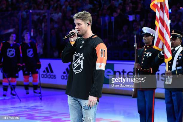 Vocalilst Brett Young sings the US National Anthem prior to the 2018 Honda NHL AllStar Game at Amalie Arena on January 28 2018 in Tampa Florida