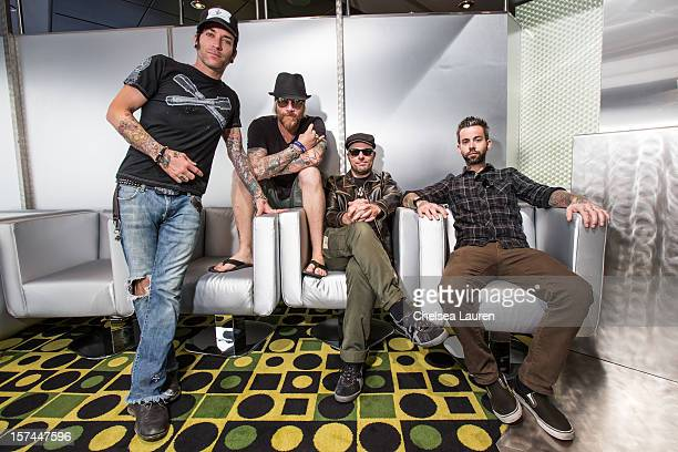 Vocalist A Jay Popoff guitarist Jeremy Popoff bassist Kevin Baldes and drummer Nathan Walker of Lit pose onboard Shiprocked cruise on November 30...