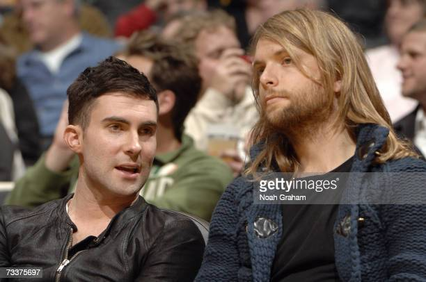 Vocalist Adam Levine and guitarist James Valentine of the band 'Maroon 5' sits courtside during the NBA game between the Charlotte Bobcats and the...
