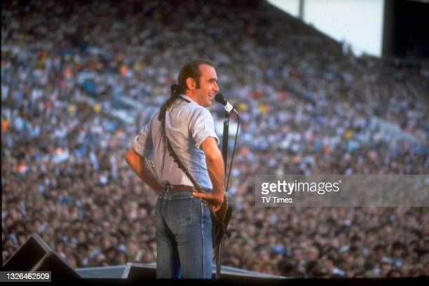 Vocalist and guitarist Francis Rossi of English rock group Status Quo performing live on stage at Maine Road stadium in Manchester, on July 16, 1986.