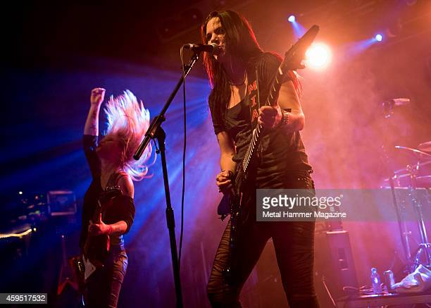 Vocalist and guitarist Mia Coldheart and guitarist Klara Force of Swedish hard rock group Crucified Barbara performing live on stage at the 2013 Hard...