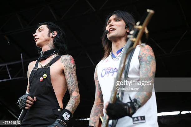 Vocalist Andy Biersack and bassist Ashley Purdy of Black Veil Brides perform during the Vans Warped Tour at Fairplex on June 19 2015 in Pomona...