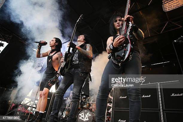 Vocalist Andy Biersack guitarist Jake Pitts and guitarist Jinxx of Black Veil Brides perform during the Vans Warped Tour at Fairplex on June 19 2015...