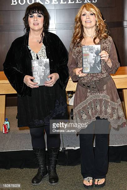 Vocalist Ann Wilson and guitarist Nancy Wilson of 'Heart' attend a signing of their memoir 'Kicking and Dreaming' at Barnes Noble bookstore at The...