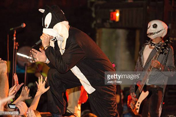 Vocalist Caleb Shomo and Bassist John Holgado of Attack Attack performs onstage in Halloween costumes in concert at The Emerson Theater on October 26...