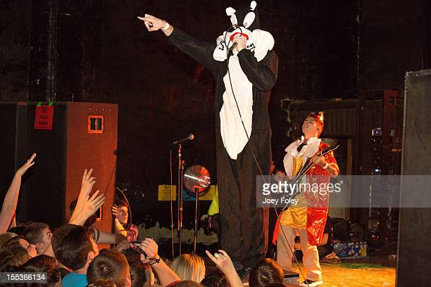 Vocalist Caleb Shomo and Guitarist Andrew Whiting of Attack Attack performs onstage in a Halloween costumes in concert at The Emerson Theater on...