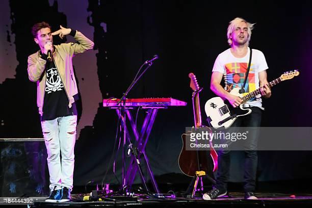 Vocalist David Boyd and guitarist Soren Hansen of New Politics perform at Staples Center on October 13 2013 in Los Angeles California