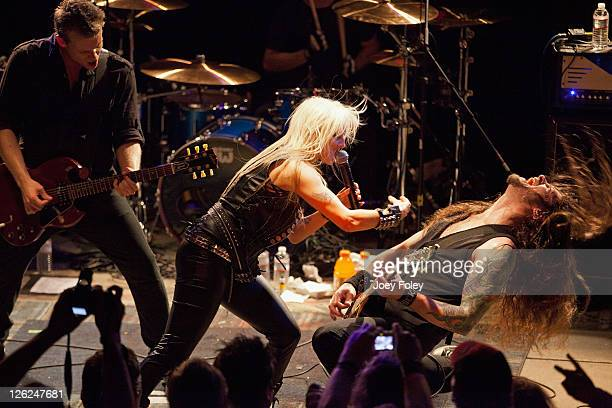 Vocalist Doro Pesch of the German heavy metal band DORO band members Luca Princiotta and Bas Maas performs onstage at Reggie's Rock Club on September...