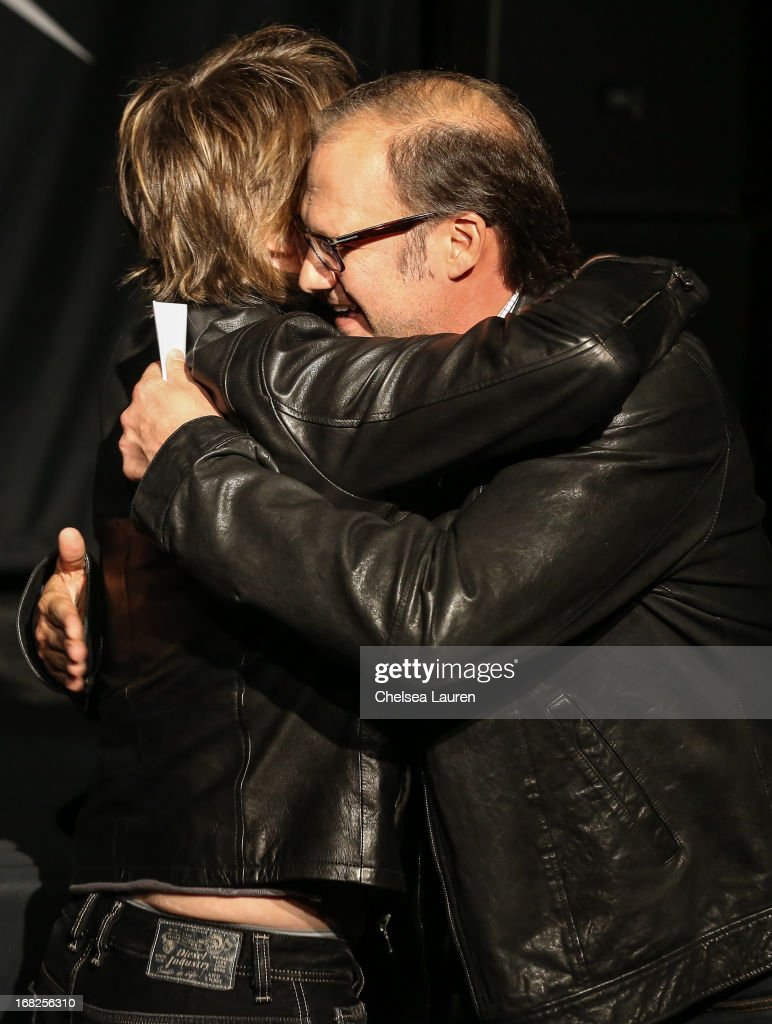 Vocalist / guitarist John Rzeznik of Goo Goo Dolls (L) and chairman of Warner Bros. Records Rob Cavallo attend the Goo Goo Dolls induction into Guitar Center's historic RockWalk at Guitar Center on May 7, 2013 in Hollywood, California.