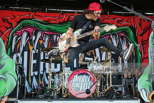 Vocalist / guitarist Vic Fuentes of Pierce the Veil performs during the Vans Warped Tour at Seaside Park on June 21 2015 in Ventura California