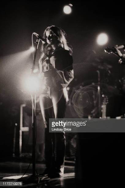 Vocalist Hope Sandoval brings her hands together as she performs in Mazzy Star at the Hollywood Palladium on November 26 1994 in Los Angeles